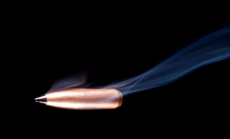 projectile: Bronze colored bullet with a black polymer tip and smoke behind