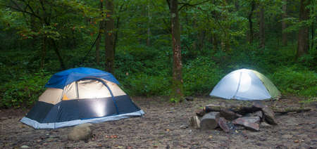 lighted: Two tents lighted from the interior in a North Carolina forest Stock Photo