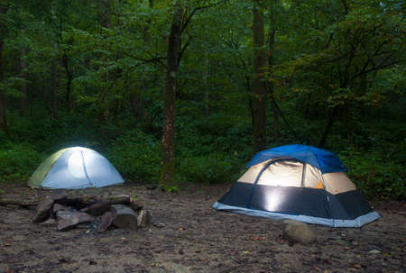 approaches: Two tents in a North Carolina forest as darkness approaches Stock Photo