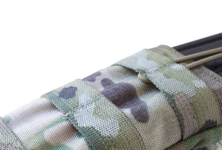 Camouflage magazine pouch with a stretching retention system Stock Photo