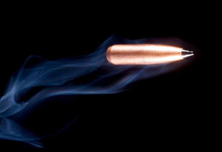 copper coated: Copper coated bullet with a polymer tip and smoke on black