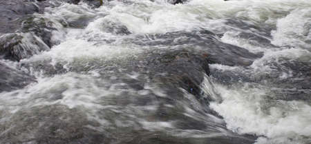 swiftly: Wilson Creek water moving swiftly over boulders in North Carolina