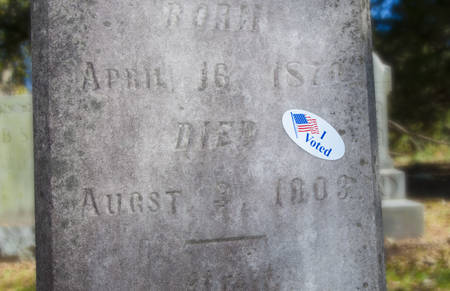 voted: I voted sticker on a grave marker from 1903