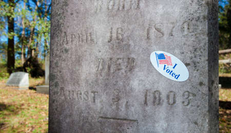 voted: Sticker on a grave marker that indicates the person voted
