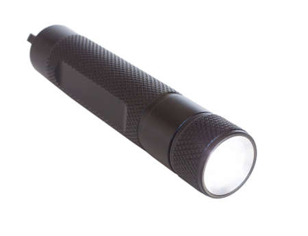 Black metal flashlight isolated on a white background