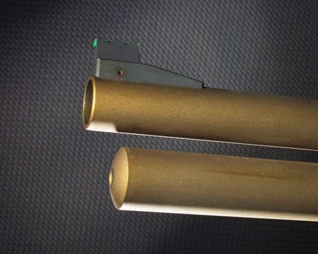Gold colored shotgun barrel with fiber optic sight and tube magazine