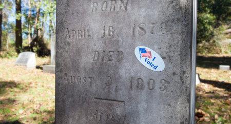 I voted sticker on a granite grave marker