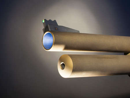 Front end of a shotgun barrel with glowing sight and tube magazine Reklamní fotografie
