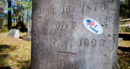 voted: Sticker that indicates a dead person has voted on a tomstone