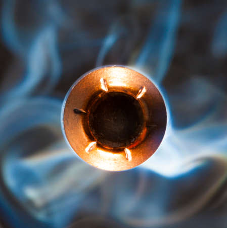 Hollow point bullet and smoke that look like they are going to hit the camera
