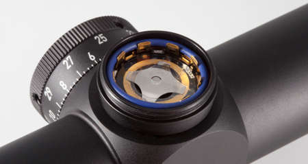 gasket: Slot that holds a battery on a rifle scope with a lighted reticle Stock Photo