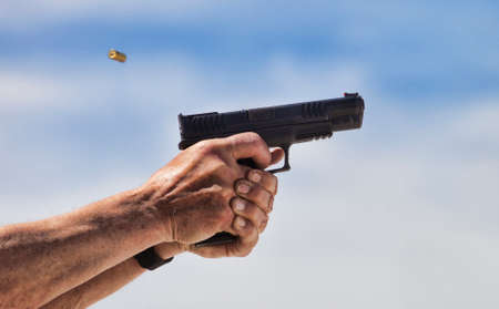 Brass flying toward the shooter as a pistol cycles