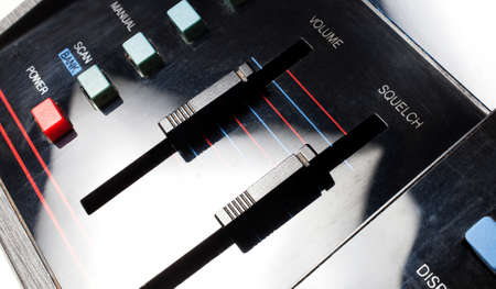Sliders used to adjust volume and squelch on an old radio Stock Photo