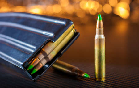 Ammunition with green bullets and magazine for an AR-15