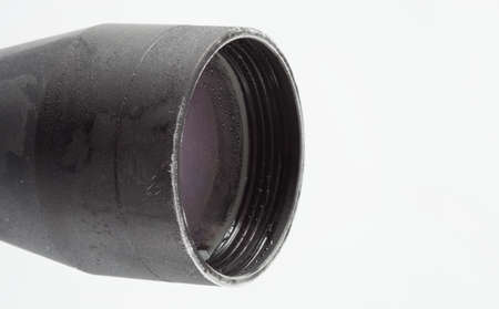 Front objective lens of a rifle scope covered in frost Banco de Imagens