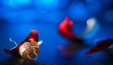 Red bulb from the Christmas tree shattered with a blue background Stock Photo