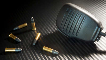 Rim fire ammunition with a police style microphone