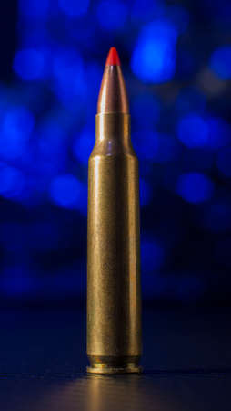 Cartridge used in an AR 15 with a blue background