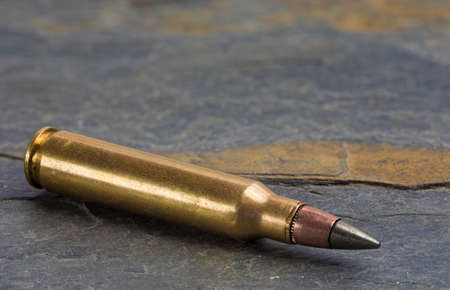 The militarys latest cartridge for its carbines on a black rock