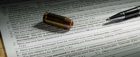 Background check to buy a gun with mental health line obvious Stock Photo