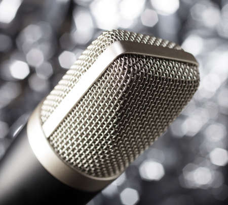 Microphone for karaoke or podcasts on a blurry white background