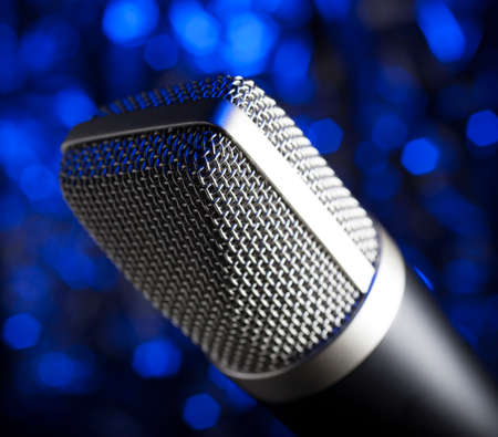 Microphone for karaoke or podcasts with a blue background