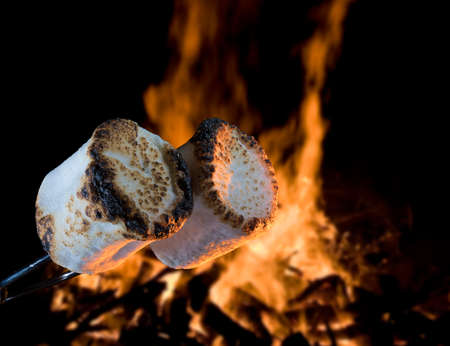 Two marshmallows being roasted over a campfire to make smores Stock Photo