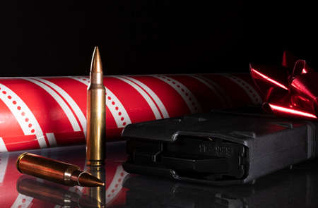 AR-15 ammunition and magazine with Christmas wrapping paper Archivio Fotografico