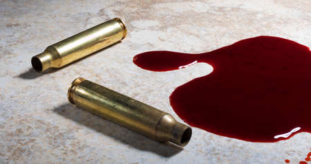Empty brass from an assault rifle on the floor with blood