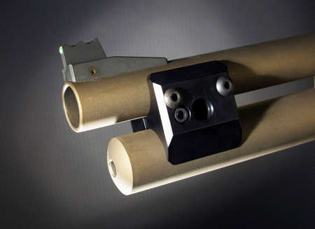 Quick disconnect and flashlight mount for a pump action shotgun