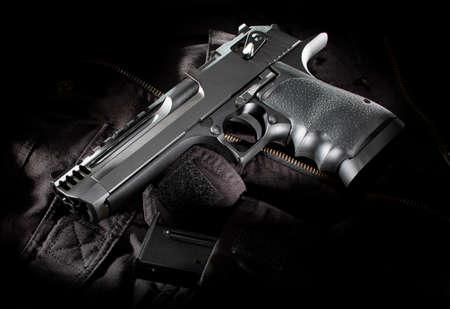 Black semi automatic handgun on a black nylon bag