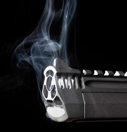 Smoking handgun with porting on a dark background 版權商用圖片