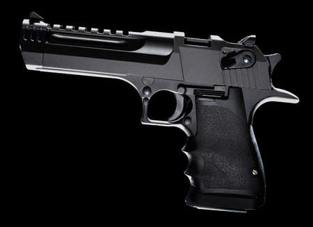 Semi automatic pistol that is on a bkack background
