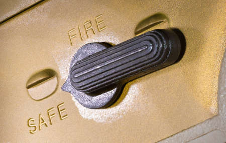 Safety in the safe position on a copper colored AR-15