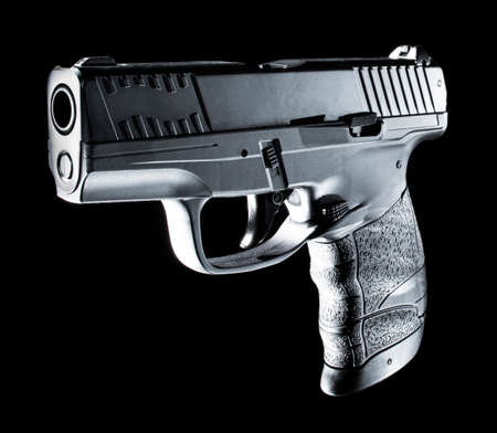 Semi automatic handgun with rim lighting on a black background Standard-Bild