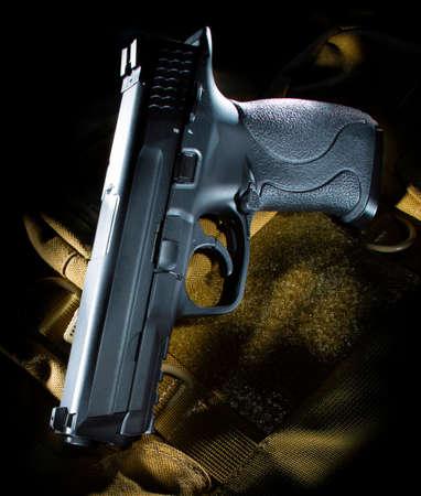 Semi-automatic black handgun on a beige bag