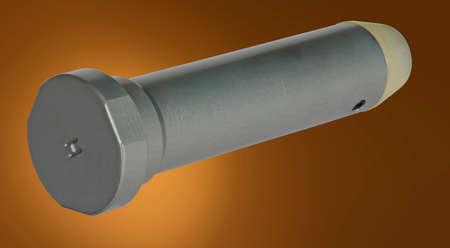 Heavy buffer weight for an AR-15 on a tan background 版權商用圖片
