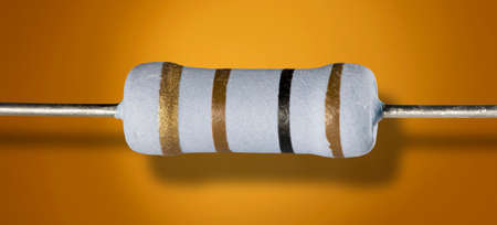 One hundred ohm resistor on an orange background with a dropshadow Imagens