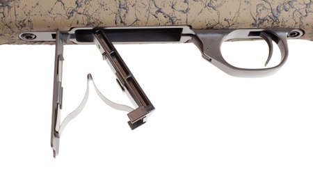 Bottom metal and trigger on a bolt action rifle Stock Photo