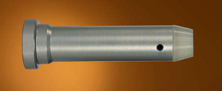 AR-15 buffer weight that is on a brown background