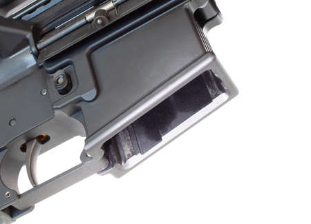 Empty magazine well on an AR-15 on a white background