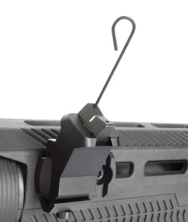 Tool being used to adjust windage in a backup iron sight on an AR-15