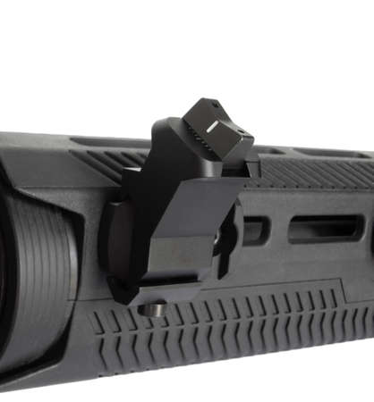 Offset iron backup sights at the back of an AR-15 on white