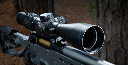 Rifle scope on a bolt action rifle in a forest
