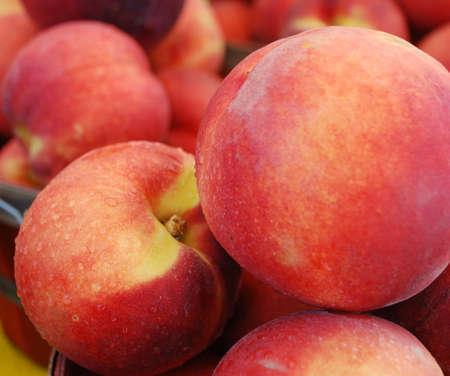 Beautiful fresh peaches close up