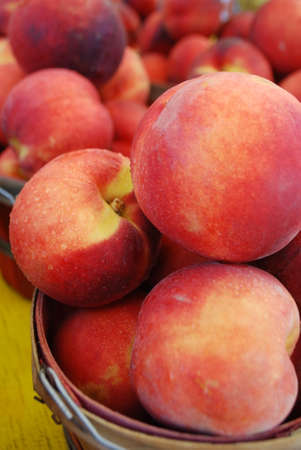 Beautiful fresh peaches in a bucket