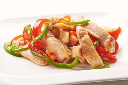 drumsticks: Smoked chicken and vegetables on white background