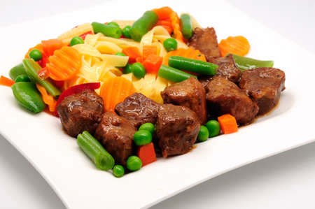 Stew Meat with pasta isolated on white background Stock Photo