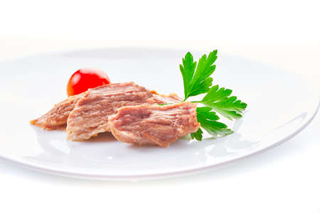 Stew Meat with herbs isolated on white background