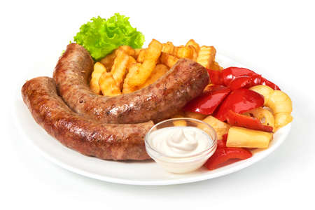grilled sausages with potatoes fries solated on white background Stock Photo
